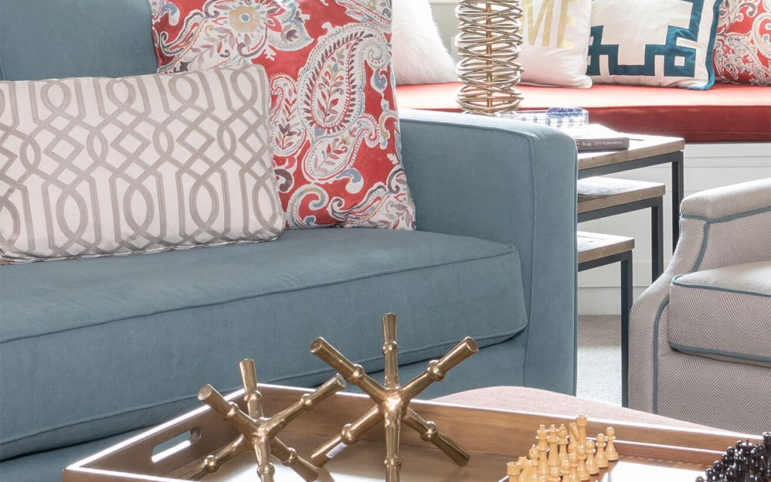 game room decor ideas, wooden board games on upholstered ottoman