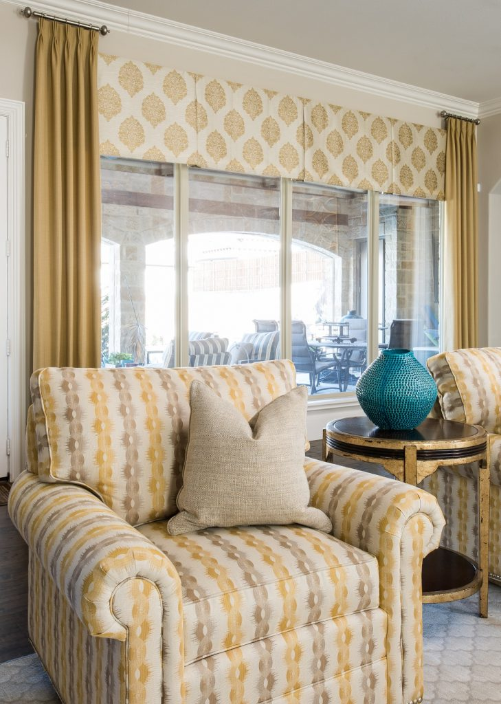 window treatment design ideas, yellow chair, gold drapes