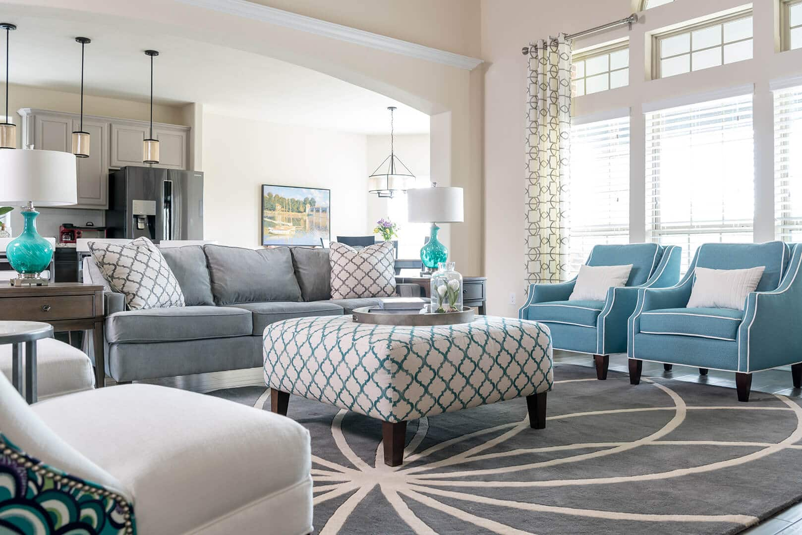 Dallas Interior Design Firms Blue & Gray Family Room Decorating Ideas with star patterned rug by Dee Frazier Interiors Decorating Den Interiors the best Dallas Interior Designer