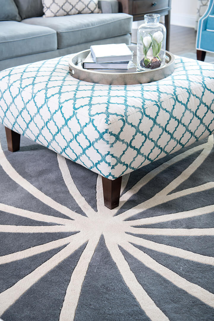 everything you need to know about interior design, Blue & Gray Family Room Decorating Ideas with star patterned rug by Dee Frazier Interiors Decorating Den Interiors the best Dallas Interior Designer