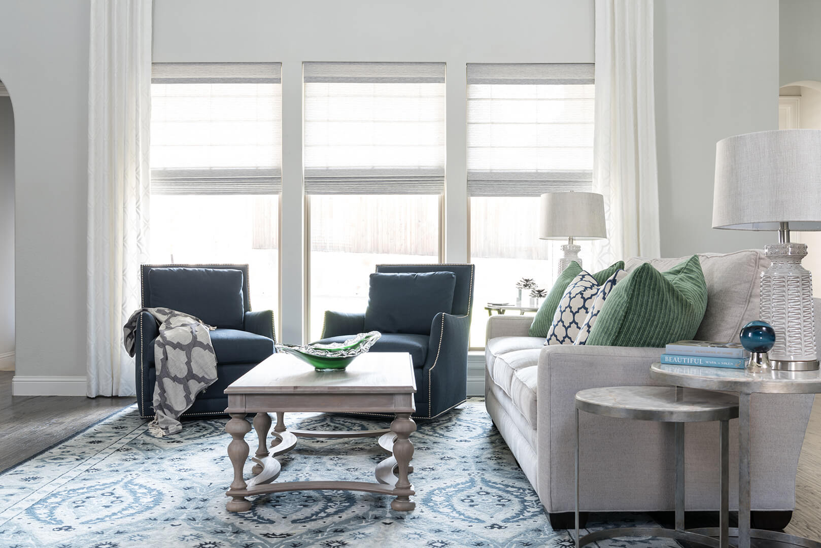 White Curtain Living Room Window Treatment Ideas with green & blue fabrics on upholstered furniture such as the chairs and sofa | Family Room Decorating Ideas | Dallas Interior Designer | Dallas Kitchen Designer