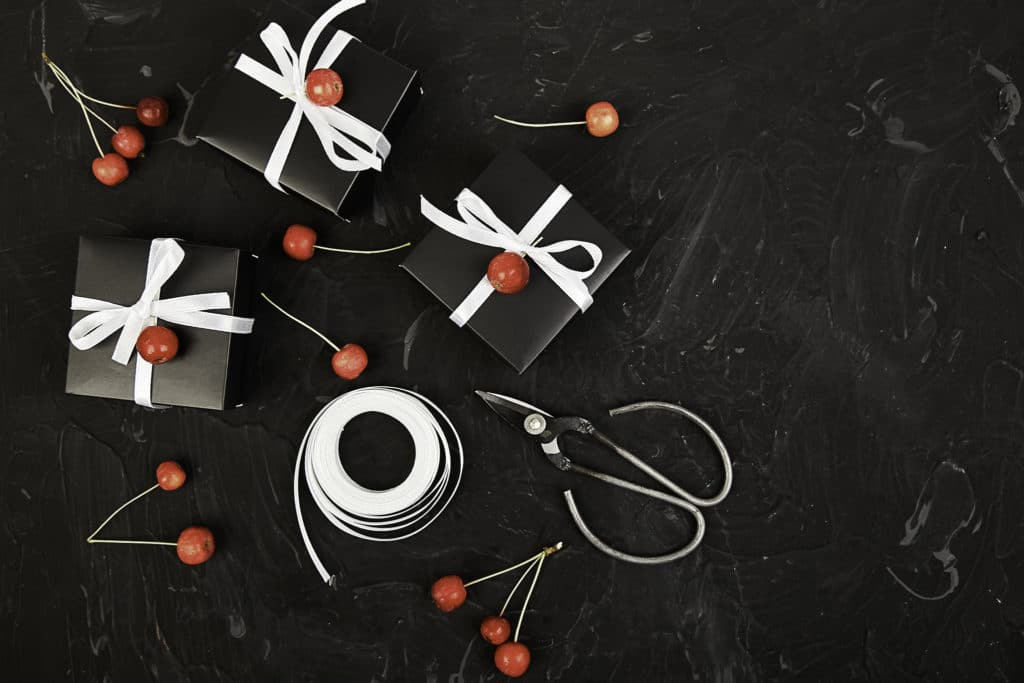 101 Holiday Gift Wrapping Ideas To Make Your Christmas Bright - A group of items on a tabletop - Design