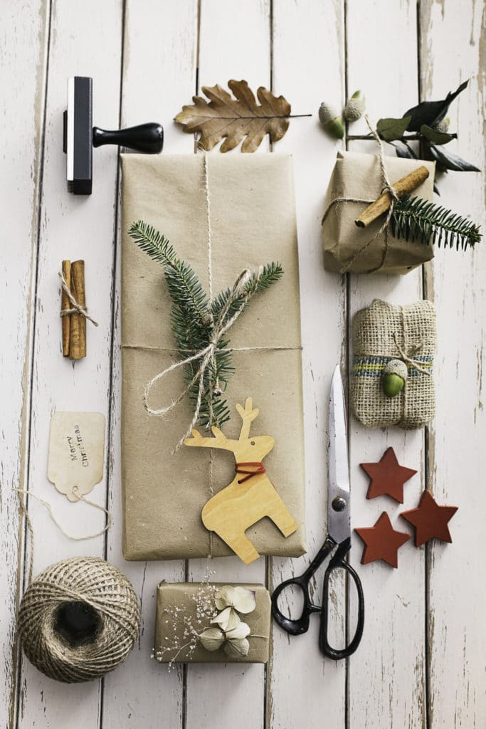 101 Holiday Gift Wrapping Ideas To Make Your Christmas Bright - A bunch of different items that are on a table - Stock photography