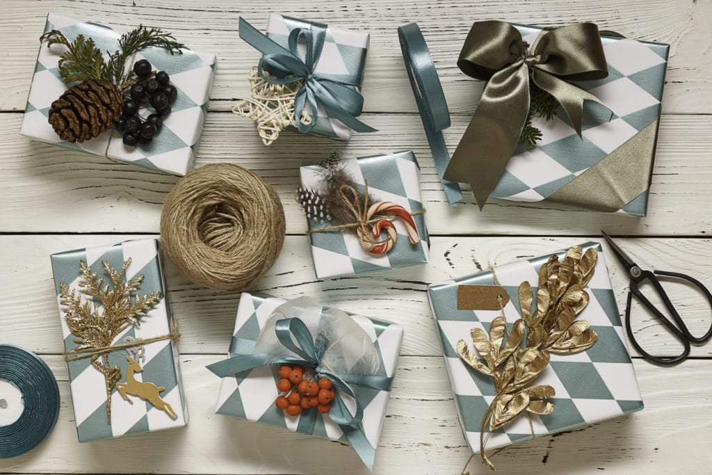 101 Holiday Gift Wrapping Ideas To Make Your Christmas Bright - A group of items on a table - Typeface