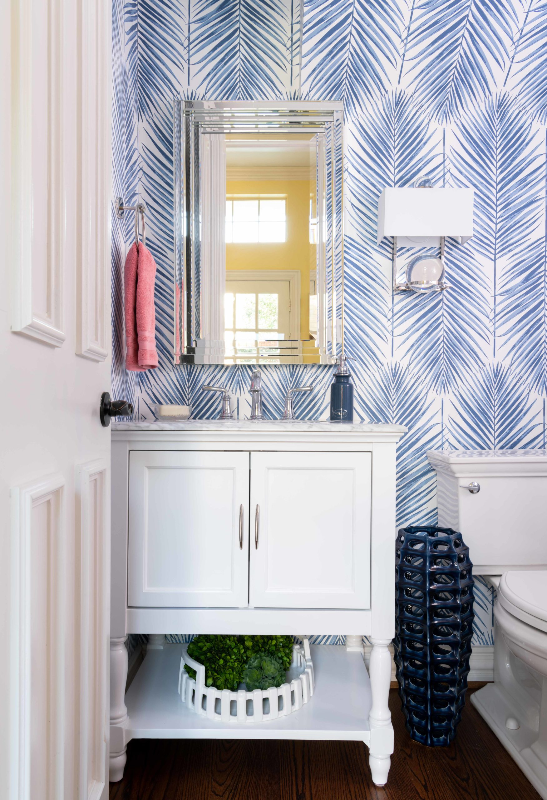 powder room ideas with blue palm leaf wallpaper with white vanity cabinet seabrook, Dallas texas, powder room, bathroom design by Dee Frazier Interiors, Dallas Interior Designers