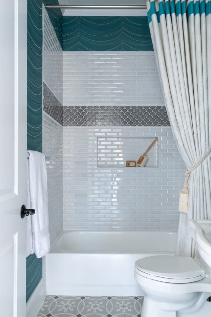 Discover ways to remodel a modern small powder room. See small powder room ideas with a pedestal sink, wallpaper ideas, custom shower treatment, & tile ideas> white subway tile, custom shower curtain, patterned floor tile, wallpaper ideas for small bathroom