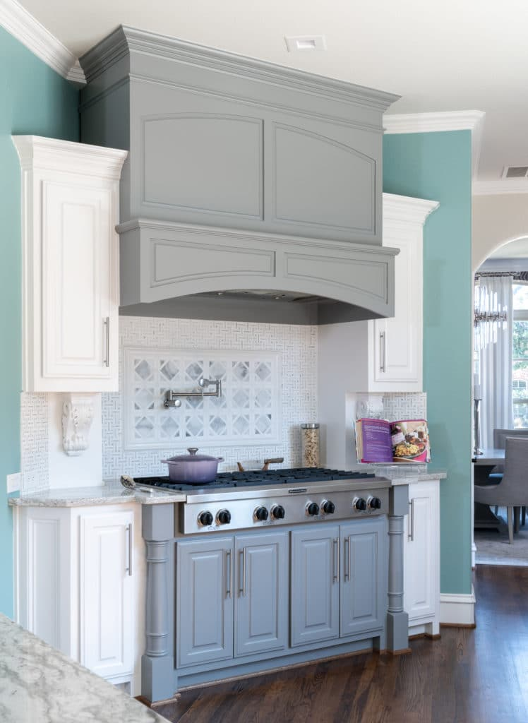 A Light Modern Kitchen Design With White Cabinets and Gray Cabinets That look like furniture around the kitchen range stove, Light To Dark Kitchen Before and After, Kitchen Backsplash Ideas, Kitchen Counter Ideas, Dark Kitchen Renovation Ideas, How To Modernize A Kitchen, Kitchen Remodel Ideas, Kitchen Remodel Near Me, Kitchen Remodel Cost, Kitchen Remodel, Kitchen Remodeling, Average Kitchen Remodel Cost, Kitchen Remodel Before and After, Kitchen Remodeling Contractors, How Much Does It Cost To Remodel A Kitchen, Kitchen and Bath Remodeling, How Much To Remodel A Kitchen, Dallas Kitchen Designer, Kitchen Designers in Dallas TX, Dallas TX Kitchen Remodel, Interior Design Blogger, Interior Designers In Dallas, NKBA Kitchen Designers In Dallas TX